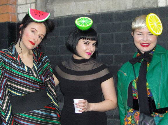 Staff wearing fruit hats
