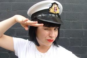 Sarah Jane wears a sailor cap to the festivals!