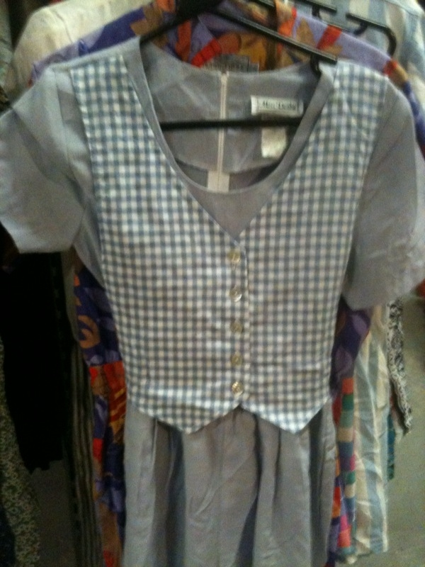 Two key trends in one with this utility inspired dress with gingham waist coat