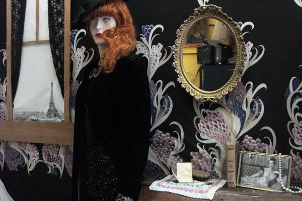 Gigi's wedding guest wears a beautiful vintage cape!