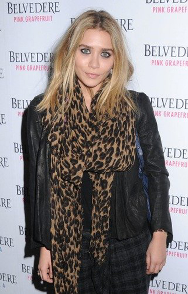 Ashley Olsen wears the iconic leopard print Louis Vuitton scarf that is a favourite among the stars.