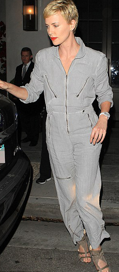 Charlize Theron accessorizes her boiler suit with heels