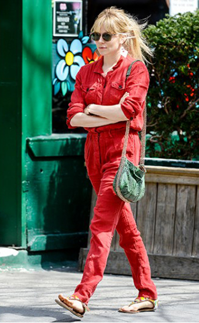 Sienna Miller works the boiler suit daytime look with sandals.